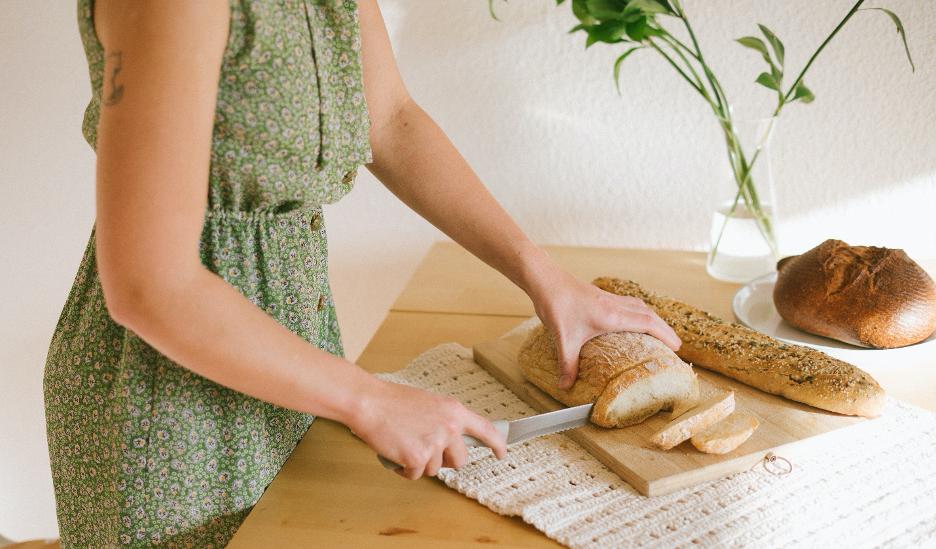 Woman slicing bread